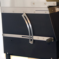 The lever on the side raises and lowers the charcoal fire inside the grill
