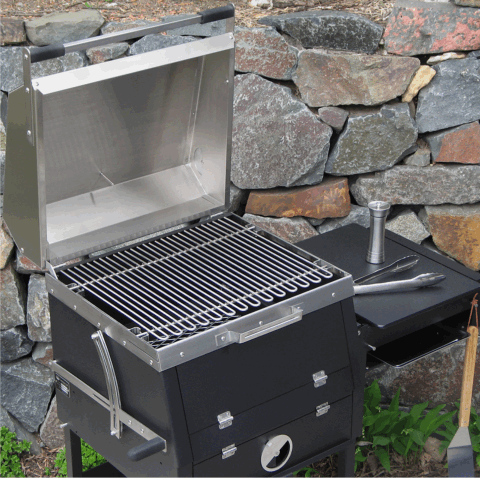 The B1 backyard charcoal grill with cover open showing how the work space is configured